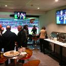 Hawkes Racing's clients enjoy the hospitality at the AFL football...