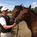 John with Helsinge and a full sister to Black Cavier